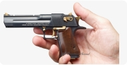 Magnum Desert Eagle Pistol miniature model in hand